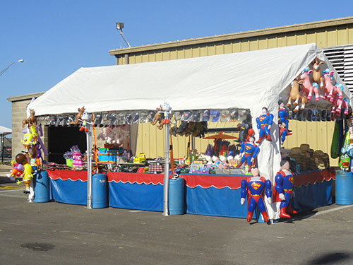 An outside vendor with inflatables at the fair